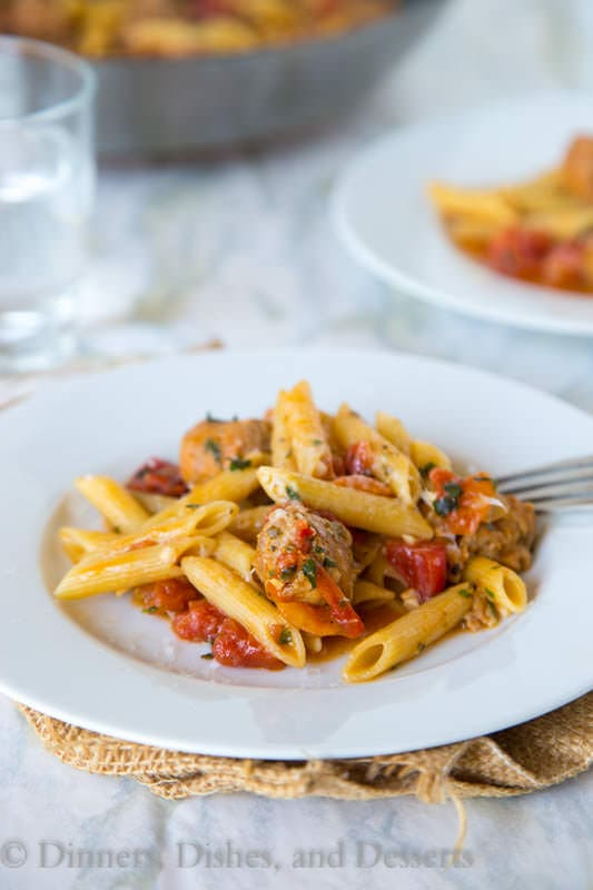 One Pot Pasta with Sausage and Tomatoes - a quick and easy one pot pasta. Everything is cooked in one pot, and dinner is on the table in 20 minutes!