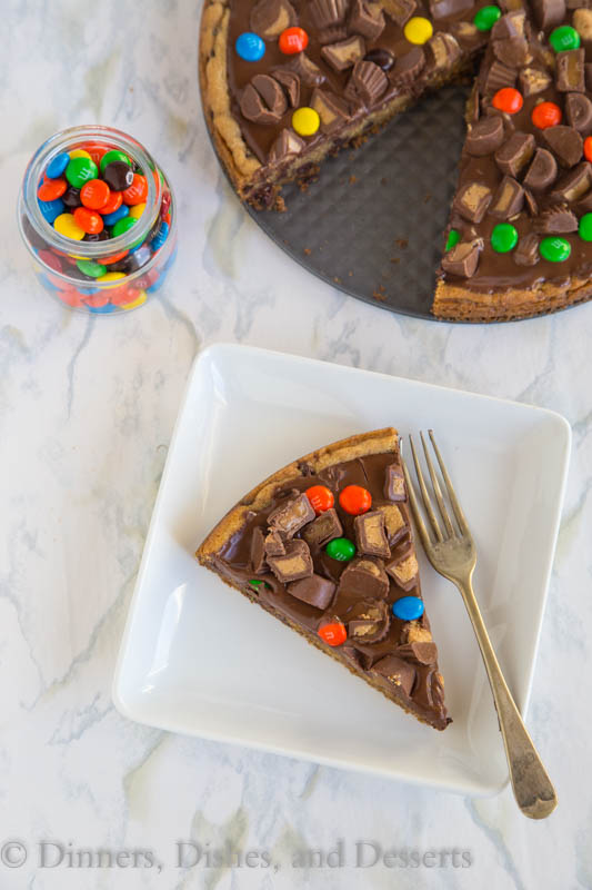 Candy Bar Cookie Pizza - a chocolate chip cookie pizza topped with melted chocolate and lots of your favorite candy!