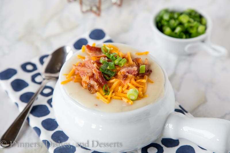 Crock Pot Potato Soup - Creamy loaded potato soup that is made in the crock pot. Perfect comfort food for a cold winter night