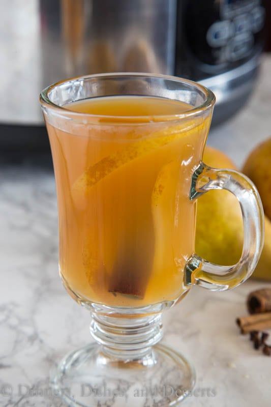Slow Cooker Spiced Pear Cider - cinnamon and clove spiced pear cider. Warm up with a combination of apple and pear juice and lots of spices!
