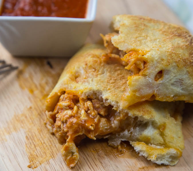 Chicken Parmesan Calzones - Just 5 ingredients until you have all the flavors of chicken parmesan, but in a hand help calzone on a weeknight!