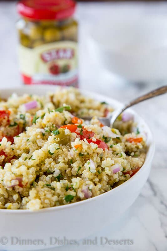 Mediterranean Quinoa Salad - a light and fresh quinoa salad with tomatoes, green olives and tossed with a lemon vinaigrette. Great warm or cold all year round!