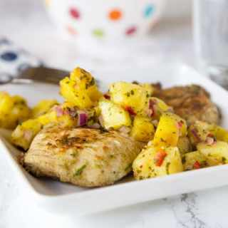 Jerk Chicken with Pineapple Salsa - a spicy and sweet grilled chicken recipe that comes together quickly. You will be craving the Tall, Dark & Delicious ice cream cake to cool down for dessert.