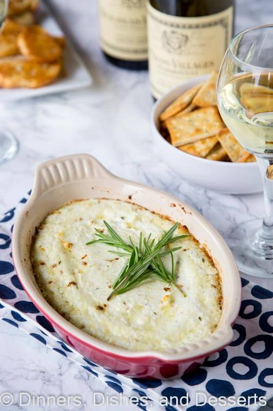 Garlic herb baked goat cheese dip in a bowl