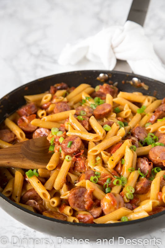 A pan filled with meat and vegetables, with Sausage and Pasta