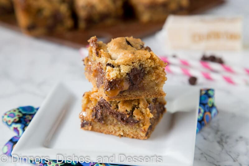 chocolate chip caramel cookie bars on a plate