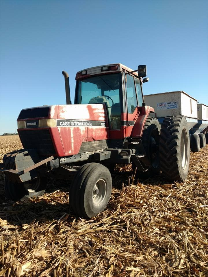 Tractor on the farm - ready to collect corn
