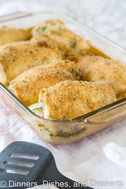 Italian Stuffed Chicken - chicken breasts rolled up with pesto, tomatoes, and cheese! Then baked until crispy and delicious, a great family dinner.