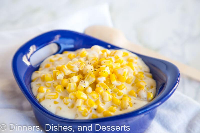 A bowl of food on a plate, with Dinner and Creamed corn