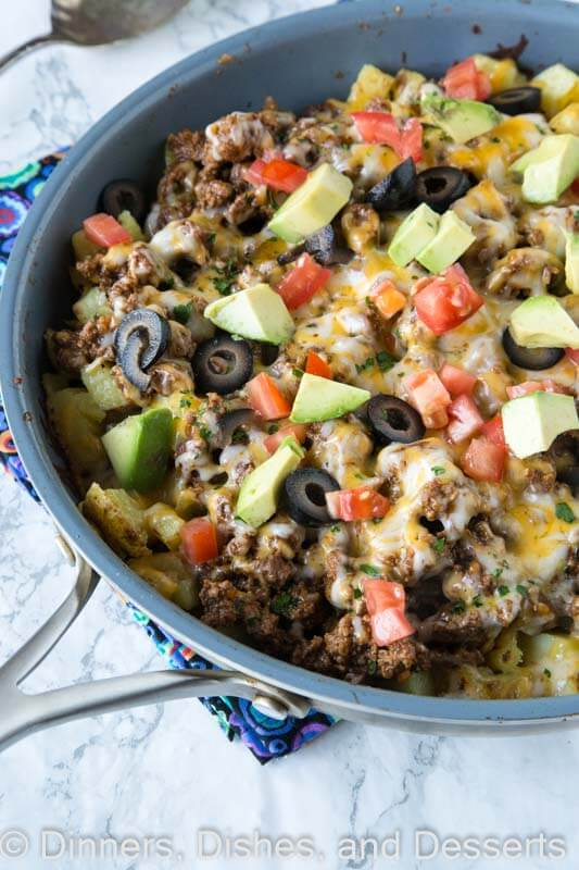 Mexican Skillet Potatoes - a quick and easy one pan Mexican recipe. Crispy potatoes, taco meat, salsa, cheese and more! So much better than just regular tacos.