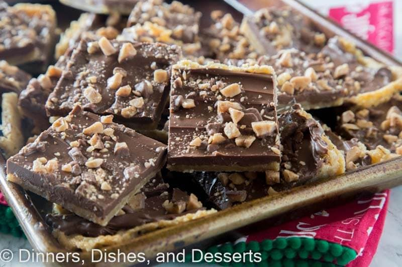 Chocolate Toffee Bars - crispy toffee flavored bars topped with chocolate and lots of bits of toffee. Just 6 ingredients, and so easy to make!