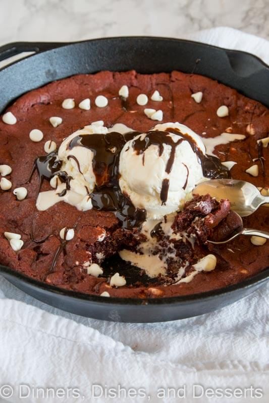 Red Velvet Skillet Cookie - a thick and chewy red velvet cookie baked in a skillet and topped with ice cream and hot fudge.