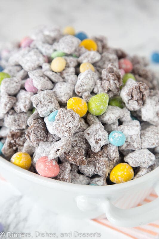 Easter Muddy Buddies - classic muddy buddies taken up a level with more peanut butter and chocolate! Plus decorated for Easter!