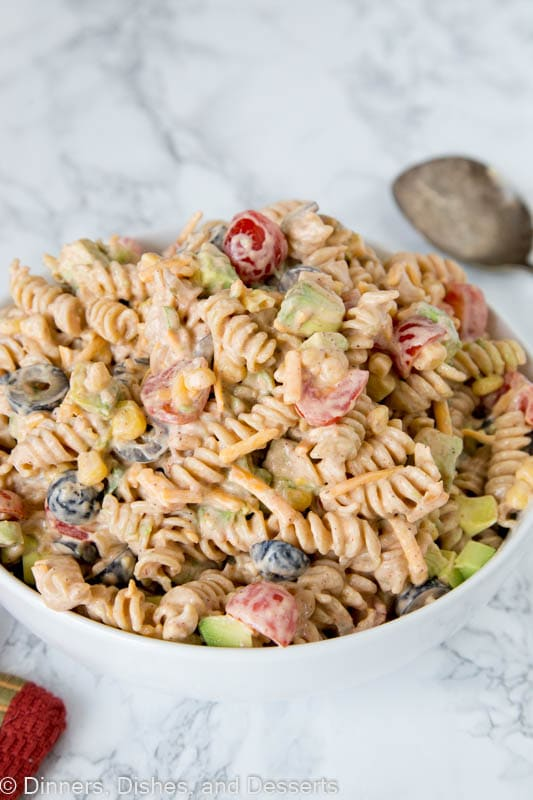 Taco Pasta Salad - a creamy pasta salad with all your favorite taco toppings! Great to make ahead and have in the fridge for dinner or to take to any get together.