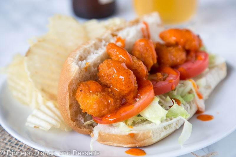 Buffalo Shrimp Po Boys - A fun twist on the classic Po' Boy using crispy fried buffalo shrimp (short cut from the store)! Add some ranch dressing or blue cheese to cool it down, or drizzle on even more buffalo sauce!