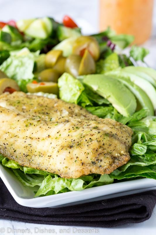 Garlic & Herb Mediterranean Salad - A crisp salad with garlic & herb tilapia and topped with a lemon garlic vinaigrette.