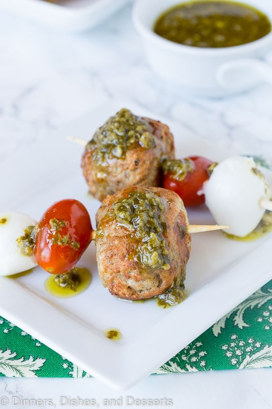 meatball skewer with mozzarella cheese, tomato, meatball and pesto