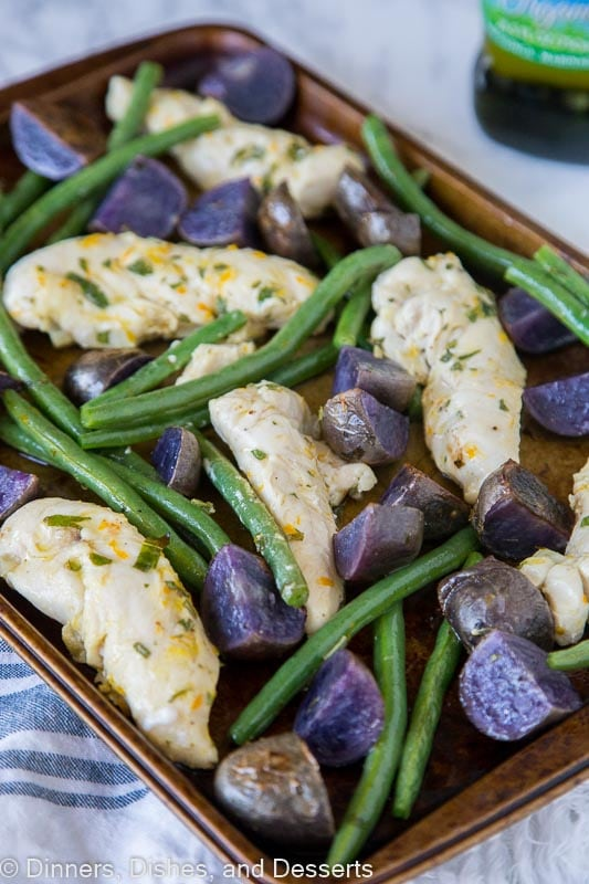 Oven Baked Chicken and Potatoes - a one pan chicken dinner with citrus, olive oil, and basil marinated chicken, green beans and roasted potatoes.