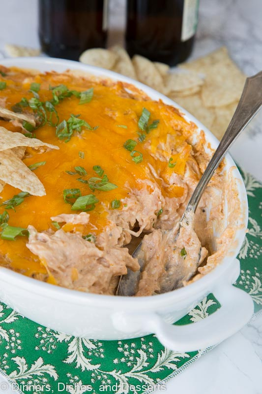 barbecue chicken dip in a dish with a spoon