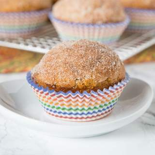 pumpkin muffin with cinnamon on top on a plate