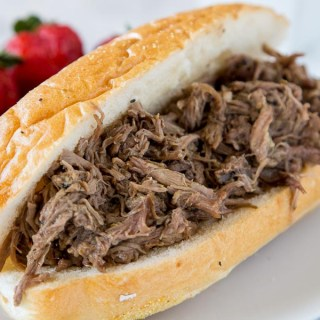 Slow Cooker Italian Beef - use your crock pot to make these super tender Italian Beef Sandwiches. Cooks all day in great spices, for a tender and flavorful dinner.