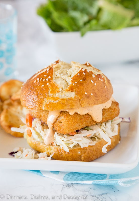 Spicy Fish Sandwich - Crispy fish sandwich with creamy coleslaw and a spicy tarter sauce. Easy dinner recipe for night of the week.