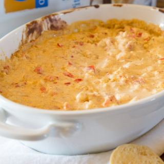 Spicy Shrimp Dip - a quick and easy dip that is great to serve at any get together. You can make ahead and heat right before guests arrive!