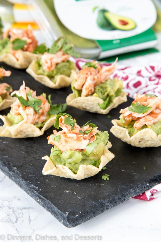 Guacamole Chicken Bites - Need a fun chicken appetizer for a party or get together.  These are filled with delicious guacamole, spicy taco chicken, and topped with cilantro.  Great for snacking or entertaining!