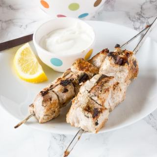 Yogurt Marinated Pork Kebobs - pork tenderloin cubes marinated in Greek yogurt and warm spices. Grilled to perfection and served with a lemon yogurt sauce! Up your summer grilling game!