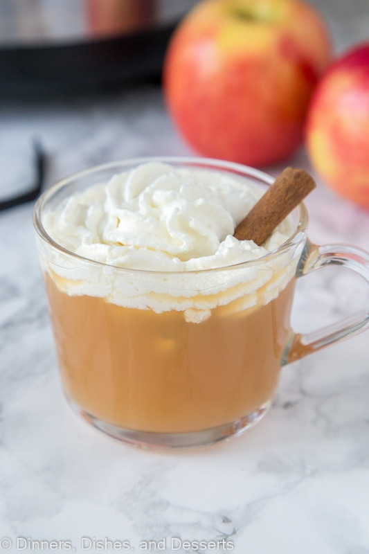 Warm Vanilla Cider - Warm up this fall with a glass of hot apple cider. Fresh vanilla bean is mixed in for a warm and delicious flavor. Topped off with homemade whipped cream for a special treat!