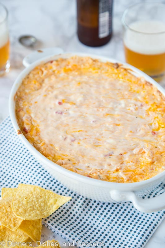 baked cheese dip in a dish with chips
