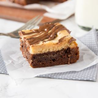 Peanut Butter Cheesecake Brownies - rich and fudgy brownies with a layer of creamy peanut butter cheesecake and topped with even more chocolate! A dessert lovers dream!