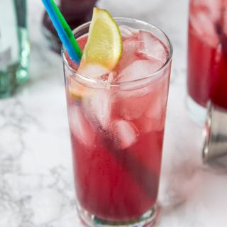 Pomegranate Gin and Tonic - a classic gin and tonic with a twist! Add pomegranate juice and a little lime juice for a sweet, tart, and delicious cocktail!