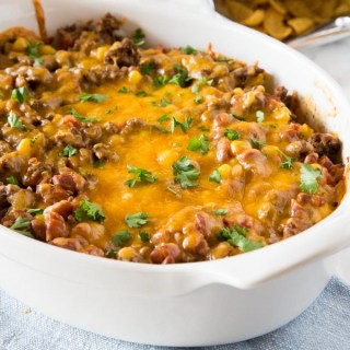 Frito Pie Recipe - a Frito taco pie recipe that is great for busy weeknights. Delicious comfort food that the whole family love.
