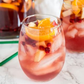 Christmas Sangria Recipe - This fun white wine sangria and all full of fall and winter flavors. It is perfect for Christmas and all your winter get togethers!
