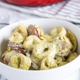 Creamy Pesto Tortellini - Cheese tortellini tossed in a creamy pesto sauce with smoked turkey sauce gets dinner on the table in 20 minutes any night of the week!