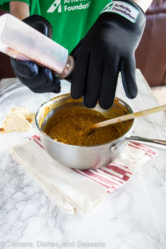 putting salt into soup
