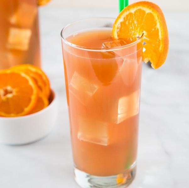 A close up of a glass of orange juice