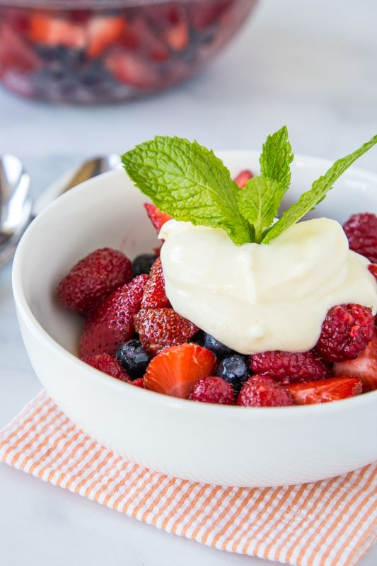 Super easy fruit salad with fresh berries and topped with a homemade lemon yogurt