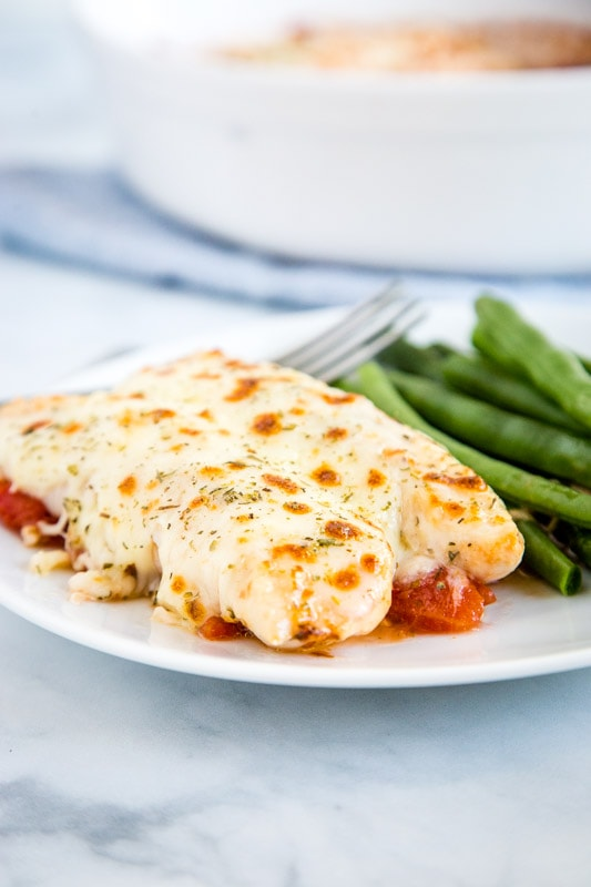 Garlic Tomato Baked Chicken plated with green beans