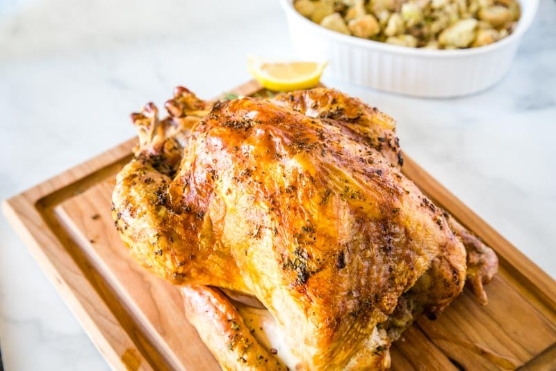 Roasted Turkey Recipe - Get the perfect oven roasted turkey for your holiday table with this simple and delicious recipe. The meat stays juicy and tender every time!