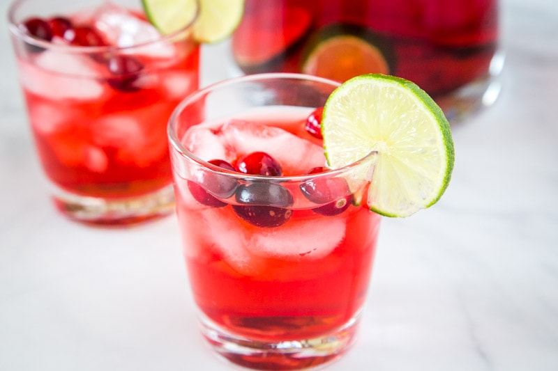 Christmas Punch Recipe - an easy and delicious holiday punch filled with cranberries, cranberry juice, pineapple juice and more!  A non-alcoholic version is included, or add in the vodka for a fun and festive holiday!