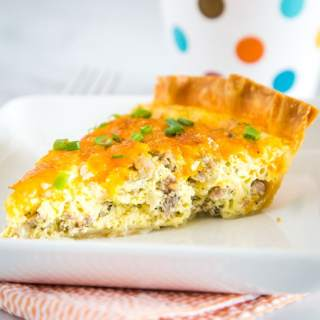 Sausage Quiche - An easy quiche recipe that is perfect for brunch or even a light dinner.  Flaky pie crust with an egg custard that is loaded with breakfast sausage, onions and plenty of cheddar cheese.