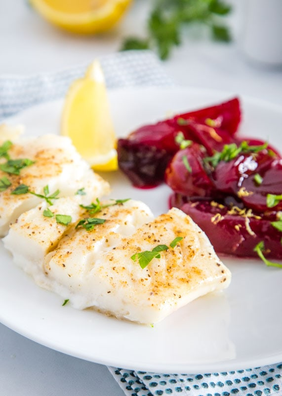 Tender cod lightly seasoned and topped with melted butter