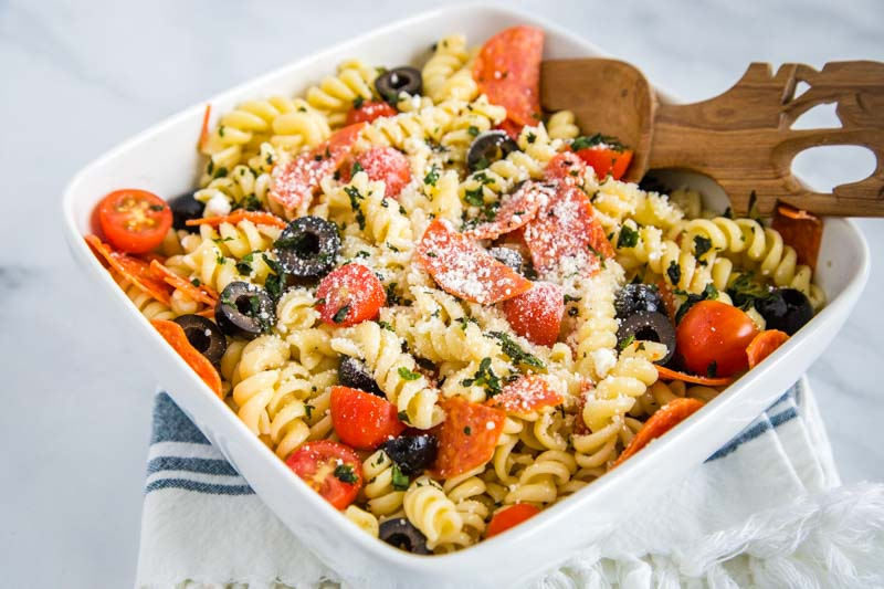 Italian Pasta Salad - a great cold pasta salad recipe that is perfect all summer long!  It is full of pepperoni, fresh tomatoes, black olives and tossed in a zesty Italian vinaigrette.