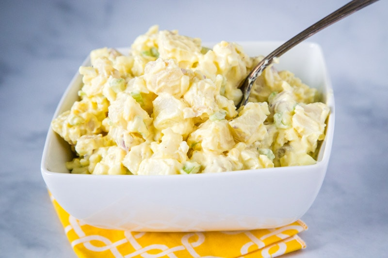 Classic Potato Salad - a homemade potato salad that is just like mom used to make.  Super creamy, tangy, easy to make and the perfect addition to any summer meal!