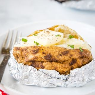 baked potato with butter on a plate