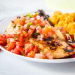 Margarita Grilled Chicken - a super easy copycat recipe from Chili's restaurant. Flavorful chicken grilled and topped with a fresh pico de gallo for an easy and delicious dinner.
