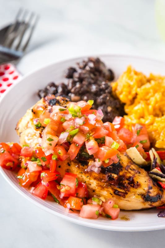 grilled chicken with tomatoes on top