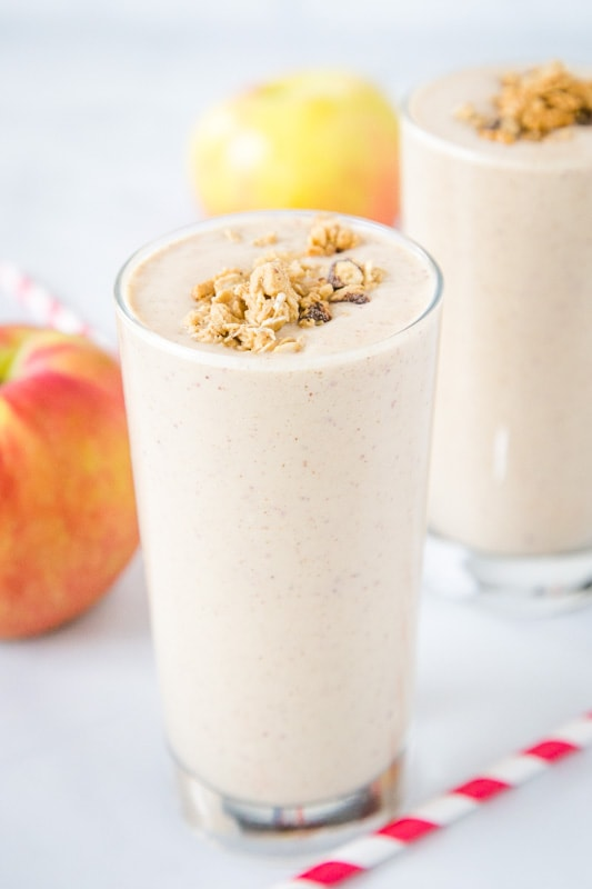 apple smoothie in a glass on a table